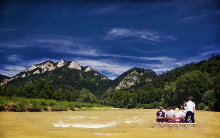 Pieniny, Dunajec rafting, yellow river of mud after several days of rainfall.