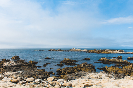 Beautiful waves break along the rocky coastal shores of the Monterey Bay, California - Big Sur, Monterey County, California 写真素材