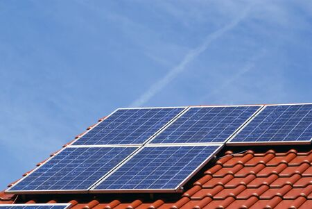 a photovoltaic power plant on the roof of a house photo