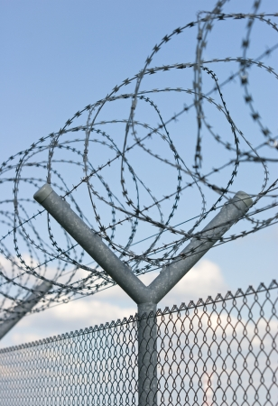 anti terrorist: a fence with barbwire for security