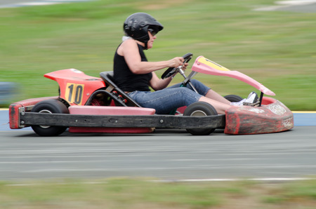 panning: girl runs on go kart: photographed with panning technique