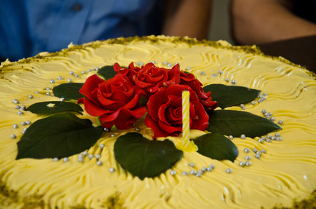 sugar paste: sweet cream cake with embossed red roses to celebrate a birthday of eighty