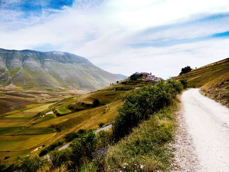 norcia: landscape of Castelluccio of Norcia: village nestled in a green valley Stock Photo