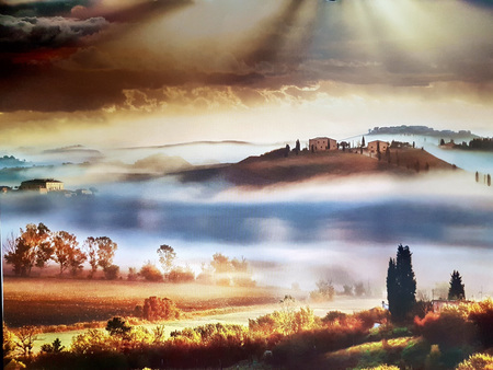Tuscan hills wrapped in the fog of the morning Banco de Imagens
