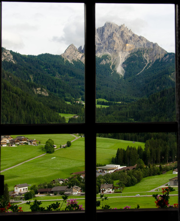 Dolomite landscapes in the summer green of Trentino
