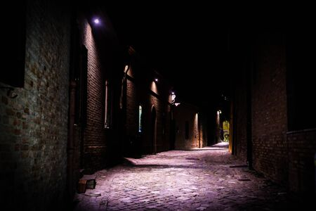 cobbled street of a medieval village in Italy, photographed at night