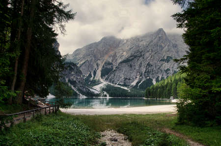 lake braies in the heart of val pusteria in trentino alto adige, a few kilometers from the border with austria