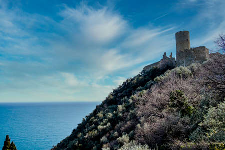 Fortification of the castle of Noli, in the homonymous town of the Ligurian Riviera on a warm winter day