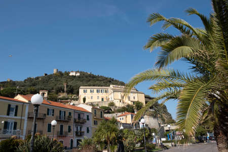 Fortification of the castle of Noli, in the homonymous town of the Ligurian Riviera, on a warm winter day