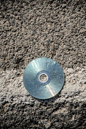 Old cd lying in the middle of the road