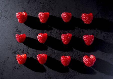 Red raspberries on black plate
