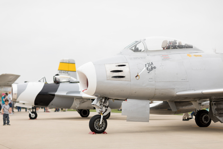 Peru, Illinois, USA - May 19, 2018 A F-86 Sabre and a Mig-17 Fresco sit at the tarmac during the TBM Avenger Salute to Veterans