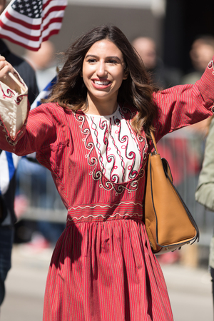 Chicago, Illinois, USA - April 29, 2018 Greek woman wearing traditional clothing during the  Greek Independence  Day Parade Standard-Bild - 107044722
