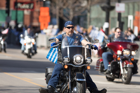 Chicago, Illinois, USA - April 29, 2018 Greek bikers carrying greek and american flags at the Greek Independence  Day Parade Editorial