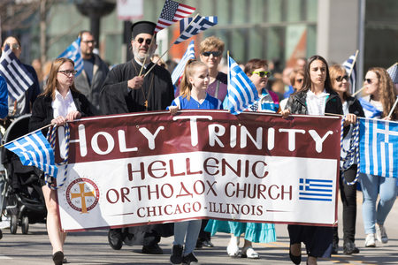 Chicago, Illinois, USA - April 29, 2018  Member of the holy Trinity Hellenic Orthodox Church at the Greek Independence  Day Parade Standard-Bild - 106862607