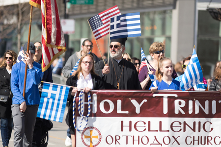 Chicago, Illinois, USA - April 29, 2018  Member of the holy Trinity Hellenic Orthodox Church at the Greek Independence  Day Parade