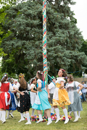 Frankenmuth, Michigan, USA - June 10, 2018 Members from the Frankenmuth dance center perform the maypole dance during the Bavarian Festival. Editöryel