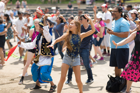 Columbus, Ohio, USA - May 27, 2018  A group of Bhangra dancers perform at the Asian Festival and the public join them in the dancing.