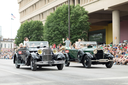 Indianapolis, Indiana, USA - May 26, 2018,  A group of collectible classic cars go down the road at the Indy 500 Parade