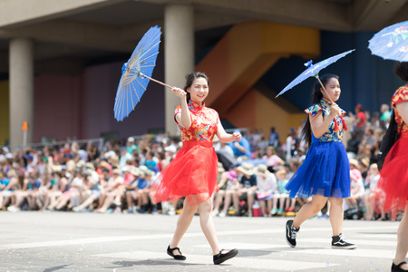 Indianapolis, Indiana, USA - May 26, 2018, Women wearing traditional chinese clothing and holding umbrellas from the Confucius Institute Indianapolis, from the IUPUI University  at the Indy 500 Parade