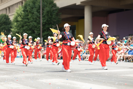 Indianapolis, Indiana, USA - May 26, 2018, Members of the Indianapolis Chinese Community Center, Inc. Playings drums  at the  Indy 500 Parade