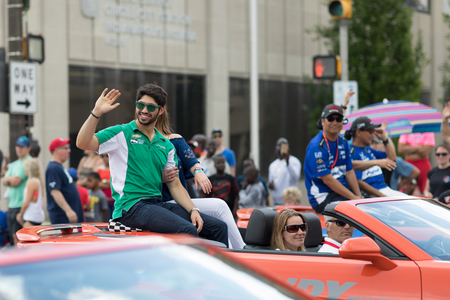 Indianapolis, Indiana, USA - May 26, 2018, Indycar driver Kyle Kaiser on a car goes down the road at the Indy 500 Parade
