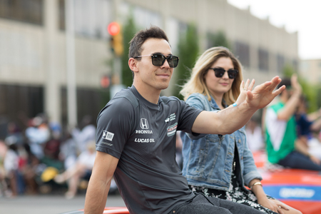 Indianapolis, Indiana, USA - May 26, 2018, Indycar driver Robert Wickens on a car goes down the street at the Indy 500 Parade