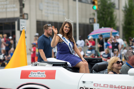 Indianapolis, Indiana, USA - May 26, 2018, Cara Mund, Miss America 2018 riding on an Oldsmobile 1970 classic car, at the Indy 500 Parade