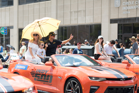 Indianapolis, Indiana, USA - May 26, 2018, Indycar driver Ryan Hunter - Reay and his family, on a car going down the road at the Indy 500 Parade Editorial