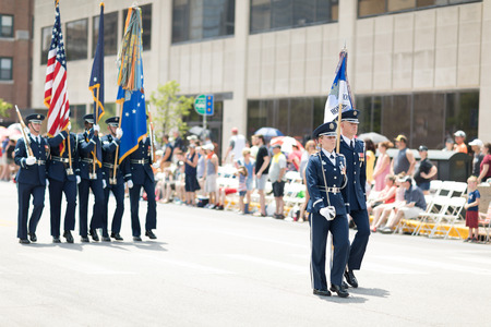 Indianapolis, Indiana, USA - May 26, 2018, Members of the US Air Force carry the American flag at the Indy 500 Parade