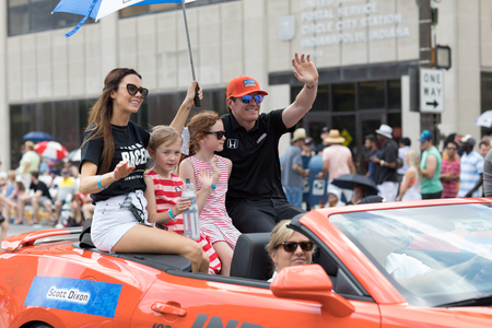 Indianapolis, Indiana, USA - May 26, 2018, Indycar driver Scott Dixon and his family on a car going down the road at the Indy 500 Parade Editorial