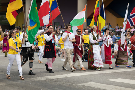 Indianapolis, Indiana, USA - May 26, 2018,  People from different countries with traditional clothing and carrying national flags at the Indy 500 Parade Redakční