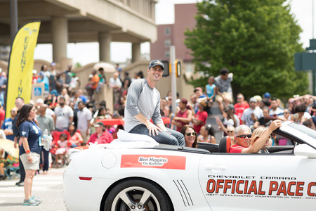 Indianapolis, Indiana, USA - May 26, 2018, Ben Higgins from the tv series The Bachelor, on a car going down the street at the Indy 500 Parade Editorial