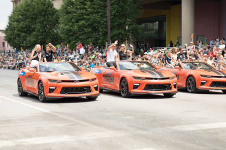 Indianapolis, Indiana, USA - May 26, 2018, Indycar drivers  Carlos Muñoz, Max Chilton and  James Davison going down the road at the Indy 500 Parade