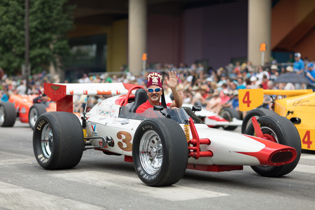 Indianapolis, Indiana, USA - May 26, 2018,  Old classic race cars drive down the road, at the Indy 500 Parade Editorial