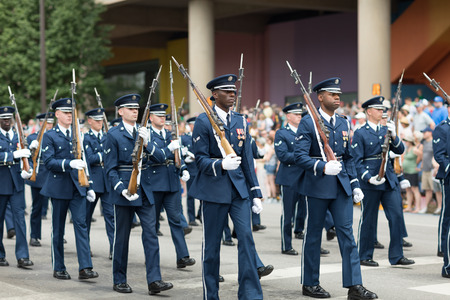 Indianapolis, Indiana, USA - May 26, 2018, Members of the US Air Force march in formation with rifles down the road at the Indy 500 Parade Editorial