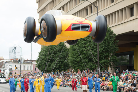 Indianapolis, Indiana, USA - May 26, 2018, People carrying a balloon in shape of a race car at the Indy 500 Parade