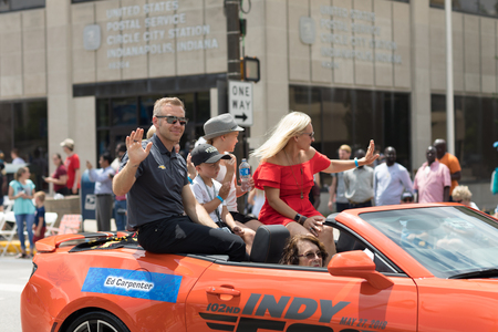 Indianapolis, Indiana, USA - May 26, 2018, Indycar driver Ed Carpenter and his family on a car going down the road at the Indy 500 Parade Editorial