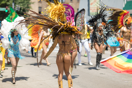 Chicago, Illinois, USA - June 24, 2018 Members from Folia Brazil e Carnaval dancing and celebrating during the LGBTQ Pride Parade in Chicago