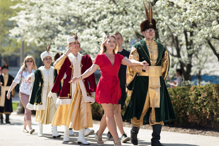 Chicago, Illinois, USA - May 05, 2018 Members of Polonia, polish folk song and dance ensemble, wearing traditional clothing, perform polish traditional dancing the Polonaise with the spectators at the Grant Park, after the Polish Constitution Day Parade. Editorial