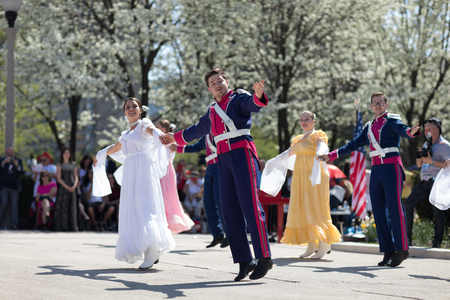 Chicago, Illinois, USA - May 05, 2018 Members of Polonia, polish folk song and dance ensemble, wearing traditional clothing, perform polish traditional dancing at the Grant Park, after the Polish Constitution Day Parade.