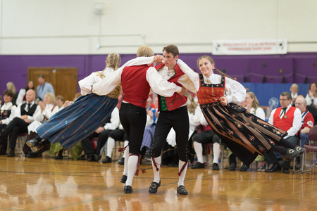 Stoughton, Wisconsin, USA - May 19, 2018 The Stoughton Norwegian Dancers, wearing traditional clothing from norway, perform traditional dances at the Community Building Performance, during the Syttende Mai Stoughton festival, Norwegian Constitution Day.