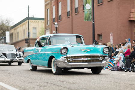 Holland, Michigan, USA - May 12, 2018 A classic Chevrolet Bel Air goes down the road at the Muziek Parade, during the Tulip Time Festival