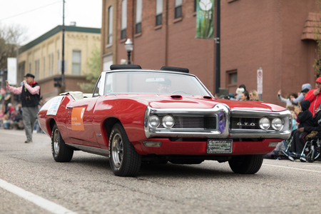Holland, Michigan, USA - May 12, 2018 A red Pontiac GTO classic muscle car at the Muziek Parade, during the Tulip Time Festival