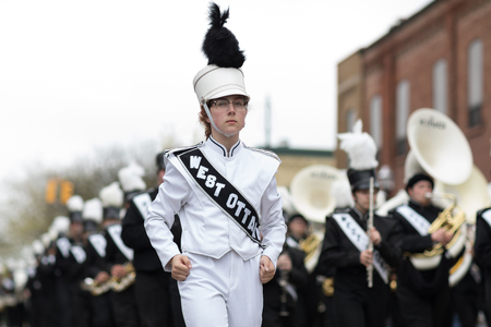 Holland, Michigan, USA - May 12, 2018 Members of the West Ottawa High School Marching Band, Holland MI, perform at the Muziek Parade, during the Tulip Time Festival Editorial