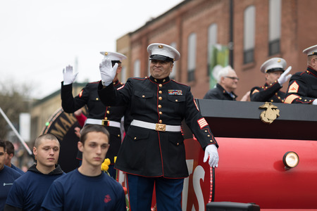 Holland, Michigan, USA - May 12, 2018 US Marines on a float wave at the spectators at the Muziek Parade, during the Tulip Time Festival