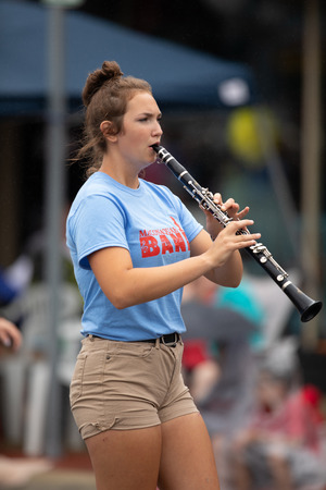 Peru, Indiana, USA - July 21, 2018 Members of the Maconaquah Marching Braves marching band perform at the Circus City Festival Parade