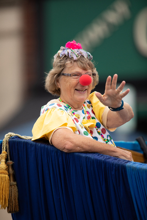 Peru, Indiana, USA - July 21, 2018 Woman wearing a clown outfit at the Circus City Festival Parade