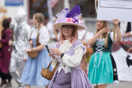 Frankenmuth, Michigan, USA - June 10, 2018 Members of the Muth Youth Community Players wearing traditional german clothing and other theater outfits at the Bavarian Festival Parade.
