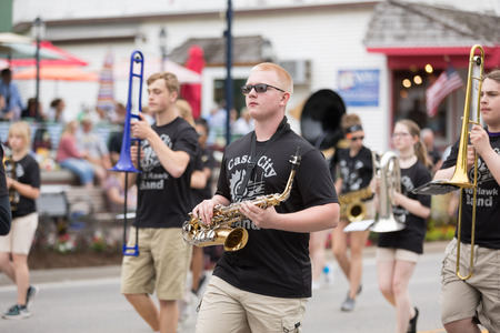 Frankenmuth, Michigan, USA - June 10, 2018 Members of the Cass City High School Marching Band perform at the Bavarian Festival Parade. Editorial
